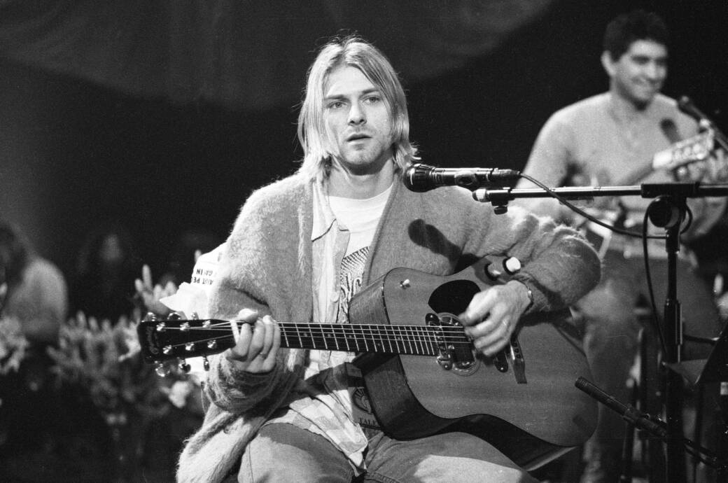 American singer and guitarist Kurt Cobain (1967 - 1994), performs with his group Nirvana at a taping of the television program 'MTV Unplugged,' New York, New York, Novemeber 18, 1993. Guitarist Pat Smear is visible at rear right. (Photo by Frank Micelotta/Getty Images)