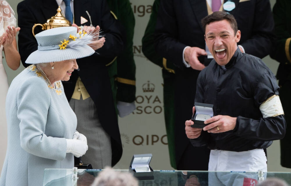 ASCOT, ENGLAND - JUNE 20: Queen Elizabeth II presents a prize to Frankie Dettori after he won the Gold Cup race on day three, Ladies Day, of Royal Ascot at Ascot Racecourse on June 20, 2019 in Ascot, England. (Photo by Samir Hussein/WireImage)